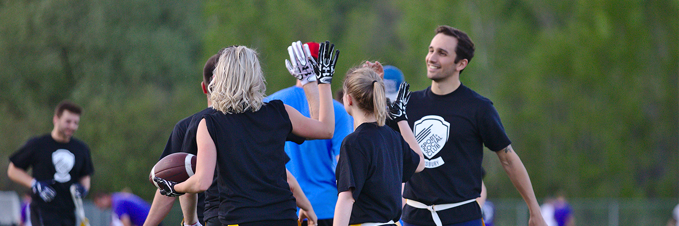 High fives after a game of co-ed flag football